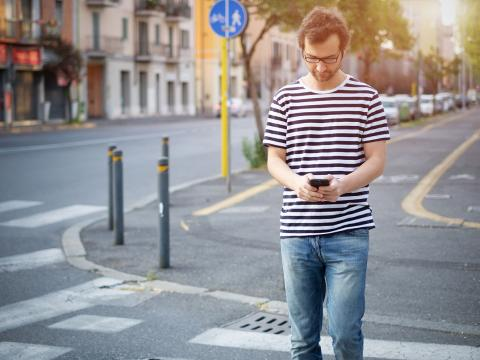 Man walking with cellphone